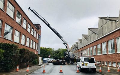 HiAb removal of air-con units from 3 story building