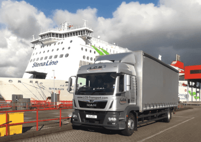 LCS Transport lorry next to boat