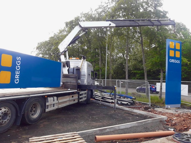 LCS lorry installing Greggs sign