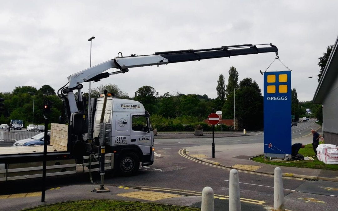 LCSlorry installing a sign
